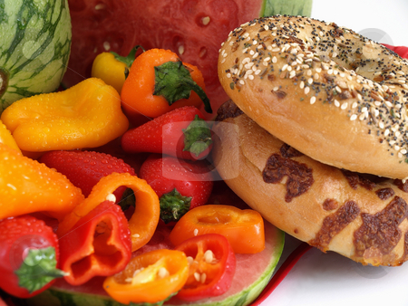 Peppers and Bread stock photo, Beautiful red, orange and yellow peppers, ripe watermelon, and bagels set against a white background. by Robert Gebbie