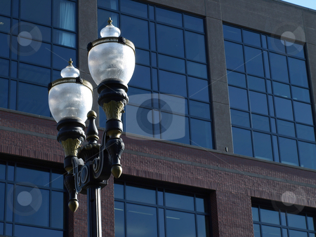 Lamp Post stock photo, Electric Lamp post outside of a modern styled building. by Robert Gebbie