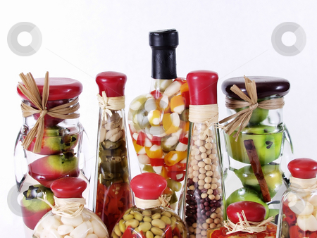 Vinegar Bottles stock photo, A colorful assortment of pickled spices in different shaped jars on white. by Robert Gebbie