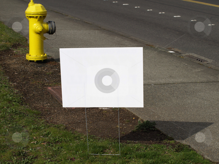 Blank Road Sign stock photo, A blank white sign on the side of the road. by Robert Gebbie