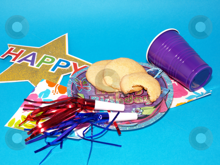 Took a Bite stock photo, Colorful party supplies for a birthday party spread on a blue background. by Robert Gebbie