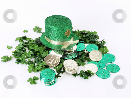 Irish Hat on clover stock photo, A green St. Patrick's Day leprechaun hat and gold and green coins on a bed of clover, on a white background by Robert Gebbie