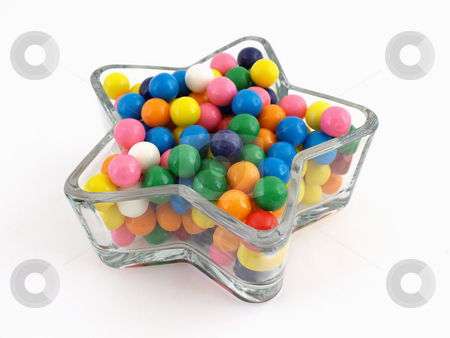 Star of Gumballs stock photo, A star shaped dish filled with multi colored gumballs isolated over a white background. by Robert Gebbie