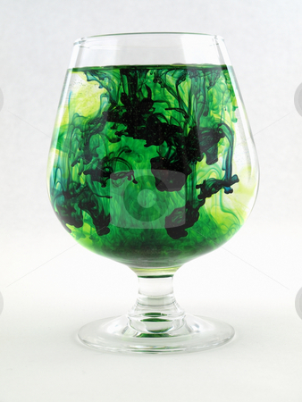 Green Color with Water stock photo, A liquid filled glass with green swirls over a white background. by Robert Gebbie