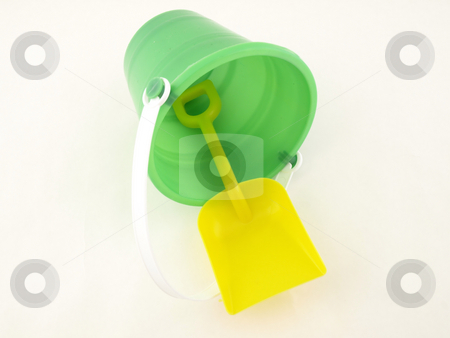 Plastic Bucket and Shovel stock photo, A plastic bucket and shovel laying on its side isolated on a white background by Robert Gebbie