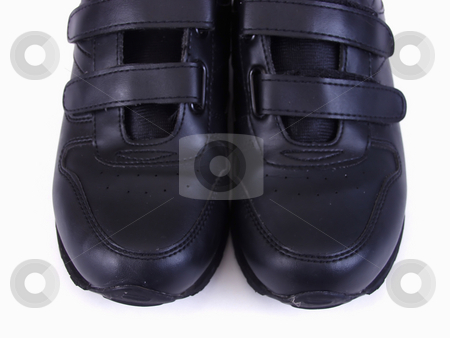 Feet Together stock photo, Two black running shoes against a white background. by Robert Gebbie