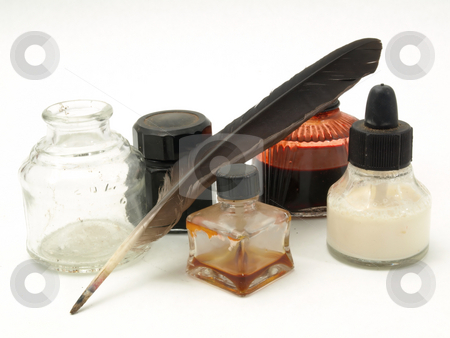 Ink Wells and Quill stock photo, Several old glass ink bottles and a well with brown quill. Isolated over white. by Robert Gebbie