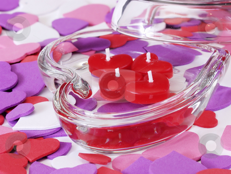 Heart Candles stock photo, Heart shaped glass dish with four little red heart shaped candles, heart shaped cutouts in various colors surrounding the dish. by Robert Gebbie