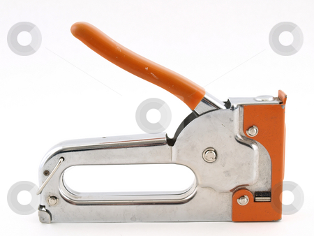 Heavy Duty Stapler stock photo, A heavy duty stapler for industrial use over a white background. by Robert Gebbie