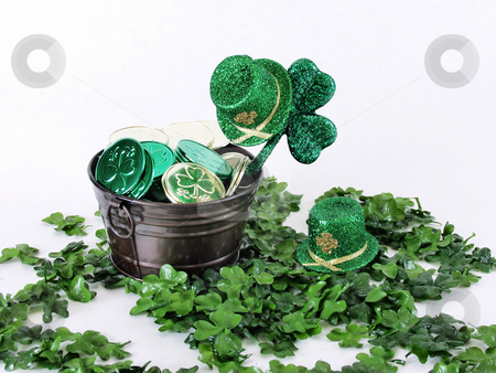 Leprechaun Treasure stock photo, A  metal bucket with coins on a bed of clover, green leprechaun hats all around, on a white background by Robert Gebbie