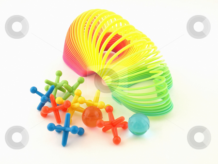 Colorful Slinky and Jacks stock photo, A colorful heart slinky and jacks isolated on a white background by Robert Gebbie