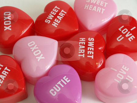 Random Hearts stock photo, Plastic heart shaped boxes with various sayings in a love theme. Over white. by Robert Gebbie