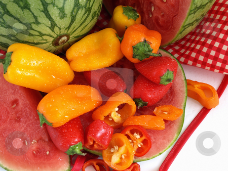 Melon and Peppers stock photo, A vibrant summer crop of fresh juicy watermelon and colorful bell peppers, with water drops, studio isolated over a white background. by Robert Gebbie