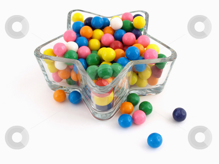 Colorful Star of Gumballs stock photo, A star shaped dish filled with multi colored gumballs isolated over a white background. by Robert Gebbie