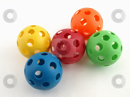 Colorful Plastic Toy Balls stock photo, Colorful plastic balls with holes isolated on a white background. by Robert Gebbie