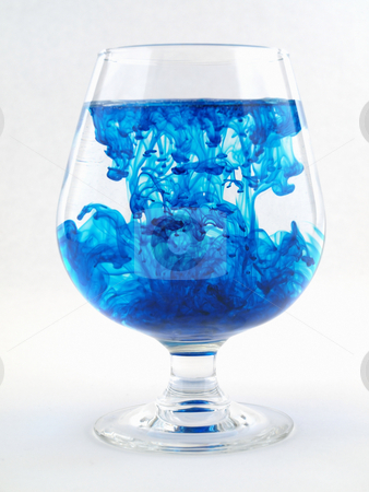 Blue Color with Water stock photo, A liquid filled glass with blue swirls over a white background. by Robert Gebbie