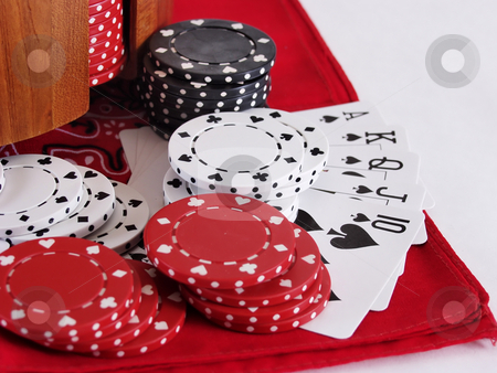 Royal in Spades stock photo, A royal flush in spades, surrounded by red, white, and black poker chips on a red bandana. Over white. by Robert Gebbie