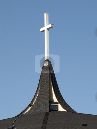 Wooden Cross on Steeple stock photo, A white wooden cross atop a church steeple. by Robert Gebbie