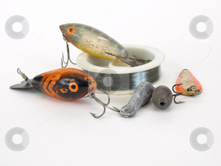 Fishing Lures and Line stock photo, Two fish shaped fishing lures with a spool of line over a white background by Robert Gebbie