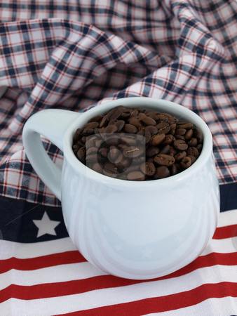 Fresh Roast Beans stock photo, A blue coffee cup full of rich fresh beans over a red white and blue background. by Robert Gebbie