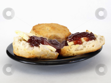 Biscuits and Jelly stock photo, Biscuits with butter and jelly on a black plate over a white background. by Robert Gebbie