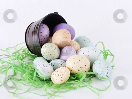 Pastel Flecked Eggs, spill stock photo, Pastel Flecked eggs spilling out from a little pail. Isolated on white by Robert Gebbie