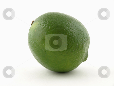 Lime on White stock photo, A solitary green lime isolated on a white background. by Robert Gebbie