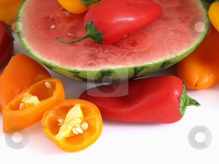 Summer Medley of Color stock photo, A vibrant summer crop of fresh juicy watermelon and colorful bell peppers, studio isolated over a white background. by Robert Gebbie