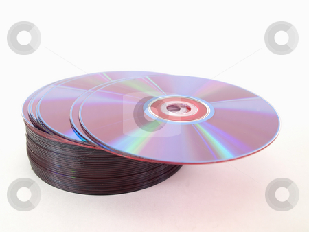 CD Stack stock photo, A small stack of blank compact discs over a white background. by Robert Gebbie