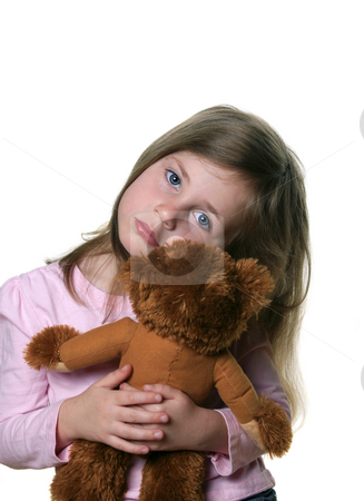 Little girl with teddybear stock photo, Little girl holding a teddy bear isolated on white and looking into camera with pensive expression by Anita Peppers