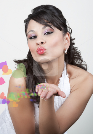 Pretty Hispanic Woman Blowing Kiss with Effects stock photo, Pretty Hispanic woman in a white top blowing kiss with effects by Scott Griessel