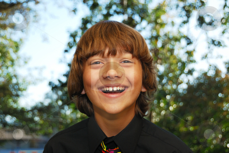 Happy Teenager stock photo, Smiling teenager dressed up in a black shirt and tie. by Denis Radovanovic