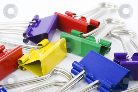 Colored folderback clips collection stock photo, Collection of colored folderback clips on white background by Gabriele Mesaglio