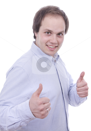 Handsome young man with thumbs up on an isolated white backgroun stock photo, Handsome young man with thumbs up on an isolated white background by Cristovao Oliveira