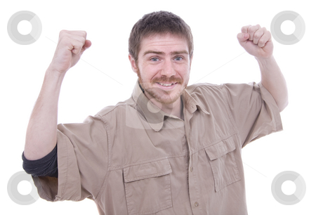 Portrait of an excited young man celebrating over white backgrou stock photo, Portrait of an excited young man celebrating over white background by Cristovao Oliveira