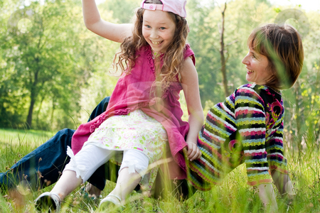 Jump Off the childhood stock photo, Mother and daughter have a happy time together by Frenk and Danielle Kaufmann