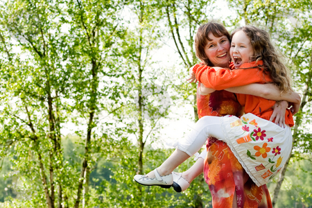 Smiling together stock photo, Mother and daughter have a happy time together by Frenk and Danielle Kaufmann