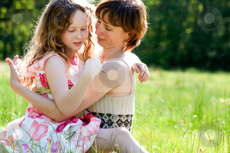 Close together stock photo, Mother and daughter have a happy time together by Frenk and Danielle Kaufmann