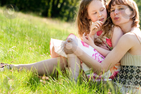 Tickling my mother with a grass blade stock photo, Mother and daughter have a happy time together by Frenk and Danielle Kaufmann