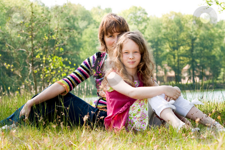 Together on the grass stock photo, Mother and daughter have a happy time together by Frenk and Danielle Kaufmann