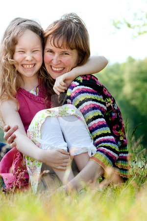 Happyness mother and daugther stock photo, Mother and daughter have a happy time together by Frenk and Danielle Kaufmann