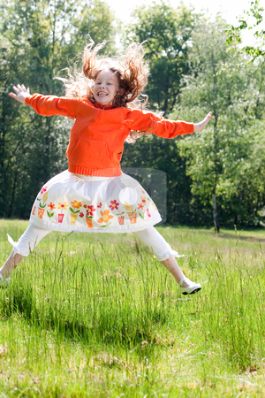 Jumping in the field stock photo, Beautifull child in the nature by Frenk and Danielle Kaufmann