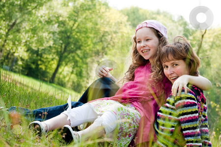 Sitting on my mom stock photo, Mother and daughter have a happy time together by Frenk and Danielle Kaufmann