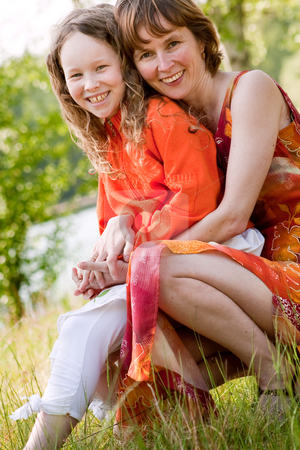 Having orange fun stock photo, Mother and daughter have a happy time together by Frenk and Danielle Kaufmann