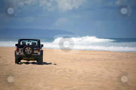 Offroad Vehicle on a Remote Beach in Hawaii stock photo, Offroad Vehicle on sand at a Remote Beach in Hawaii by Katrina Brown