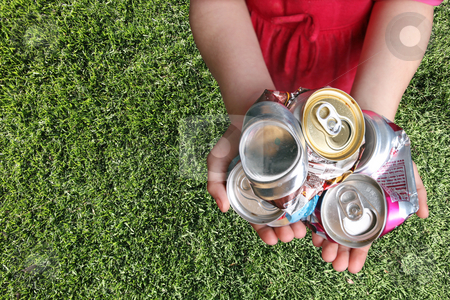 Aluminum Cans Crushed For Recycling stock photo, Aluminum Cans Crushed For Recycling in a Childs Hands by Katrina Brown