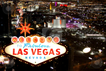 Las Vegas Welcome Sign With Night Time Strip in the Background stock photo, Las Vegas Welcome Sign With the Strip in the Background by Katrina Brown