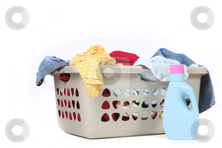 Household Chore of Laundry Waiting to Be Done stock photo, Full Basket of Dirtly Laundry With Detergent Ready to Be Washed by Katrina Brown