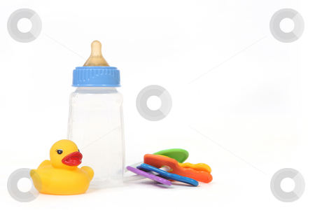 Infant Baby Bottle With Rubber Duckie stock photo, Infant Baby Bottle With Rubber Duckie on White Background by Katrina Brown