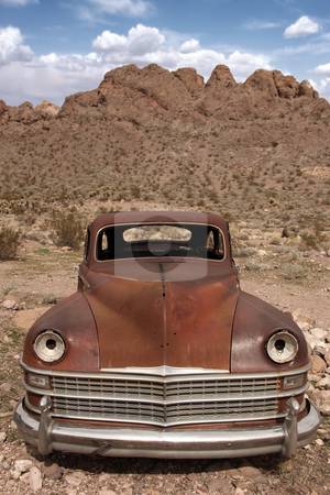 Old Rusted Out Car in the Desert stock photo, Old Rusted Out Car in the Desert Landscape by Katrina Brown